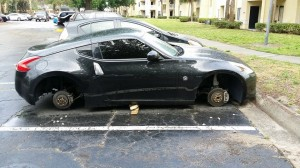 Student reported his wheels stolen off his car while parked in an off-campus complex.
