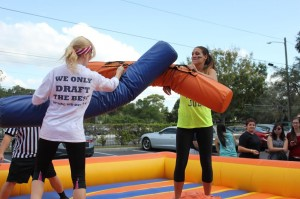 UCF Greeks face off in the inflatable jousting ring.