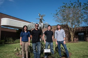 Mechanical Engineering Majors, in order from left to right: Jennifer Ambrosa, Chad Robinson, Cullen Fitzgerald, and Anthony Defilippo, stand in front of the newly repaired Pegasus Sculpture, on September 22nd, 2015.