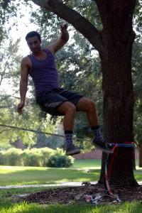 Matt Morin working on slacklining tricks at UCF main campus. Photo by Chelsea Santiago.