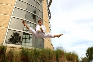 In front of the UCF Recreation and Wellness Center, Woodard practices his Flying Russian Kick, traditionally called